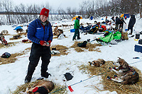 Aliy Zirkle boots her dogs as she gets ready to leave the Eagle Island checkpoint on Saturday March 9th during the 2019 Iditarod Trail Sled Dog Race.<br /> <br /> Photo by Jeff Schultz/  (C) 2019  ALL RIGHTS RESERVED