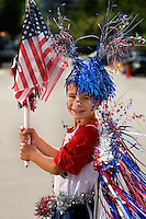A boy shows off his painted face at the annual Fourth of July Celebration and community parade in Birkdale Village in Huntersville, NC. Birkdale Village combines the best of shopping, dining, apartments and entertainment venues within a 52-acre mixed-use development.