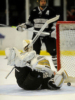 30 December 2007: Western Michigan University Broncos' goaltender Jerry Kuhn, a Freshman from Southgate, MI, tumbles on the ice as he gives up the lone goal scored by the Holy Cross Crusaders at Gutterson Fieldhouse in Burlington, Vermont. The teams skated to a 1-1 tie, however the Broncos took the consolation game in a 2-0 shootout to win the third game of the Sheraton/TD Banknorth Catamount Cup Tournament...Mandatory Photo Credit: Ed Wolfstein Photo