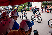 peloton with Tao Geoghegan Hart (GBR/INEOS Grenadiers) rolling through town<br /> <br /> Stage 3 from Lorient to Pontivy (183km)<br /> 108th Tour de France 2021 (2.UWT)<br /> <br /> ©kramon