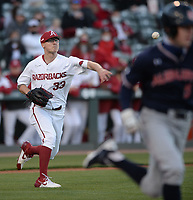 Arkansas starter Patrick Wicklander throws to first Thursday, April 1, 2021, during the second inning of the Razorbacks' 2-1 loss to Auburn at Baum-Walker Stadium in Fayetteville. Visit nwaonline.com/210402Daily/ for today's photo gallery. <br /> (NWA Democrat-Gazette/Andy Shupe)
