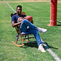 ROCKLIN, CA - Jerry Rice of the San Francisco 49ers poses in a rocking chair during training camp at Sierra College in Rocklin, California in 1988. Photo by Brad Mangin
