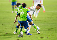 CARSON, CA - SEPTEMBER 27: Cristian Pavon #10  of the Los Angeles Galaxy moves with the ball during a game between Seattle Sounders FC and Los Angeles Galaxy at Dignity Heath Sports Park on September 27, 2020 in Carson, California.