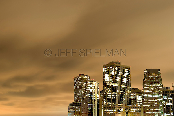 Skyline of Lower Manhattan's Financial District, Illuminated at Dusk, with Cloudy Sky, New York City, New York State, USA