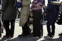 Pictured: A young boy joins adults in a queue  Thursday 03 March 2016<br />