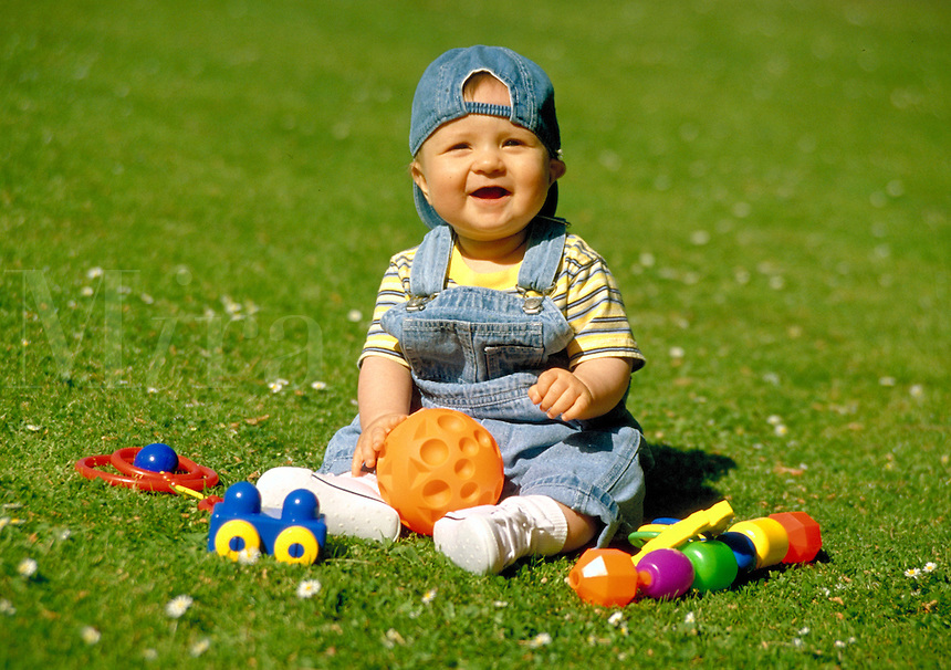 Portrait of baby Alexander playing with his toys, smiling, happy, babies, boy, boys. Baby Alexander. Santa Monica California.