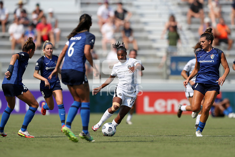 CARY, NC - SEPTEMBER 12: Crystal Dunn #19 of the Portland Thorns FC weaves through Carson Pickett #4, Abby Erceg #6, and Cari Roccaro #21 of the North Carolina Courage during a game between Portland Thorns FC and North Carolina Courage at Sahlen's Stadium at WakeMed Soccer Park on September 12, 2021 in Cary, North Carolina.