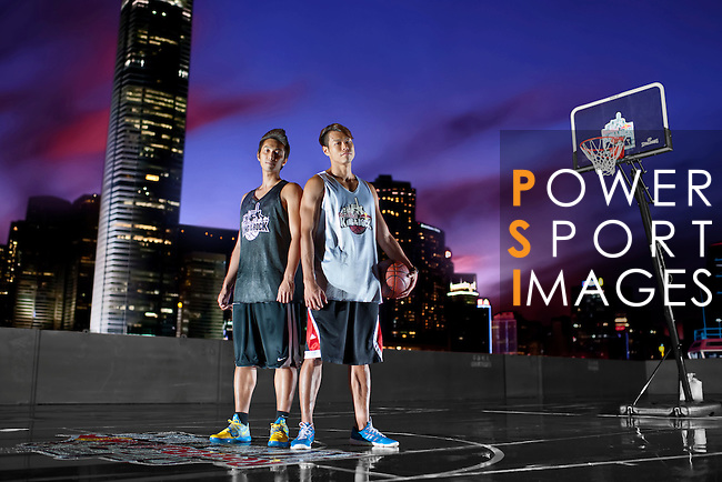 Fong Shing Yee and Chor Wai Lui pose on a pontoon basket court in front of the Hong Kong skyline after the Hong Kong's Red Bull King of the Rock on September 1, 2012 in Hong Kong. Photo by Victor Fraile / The Power of Sport Images