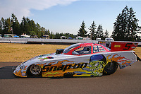 Aug. 1, 2014; Kent, WA, USA; NHRA funny car driver Cruz Pedregon on the return road during qualifying for the Northwest Nationals at Pacific Raceways. Mandatory Credit: Mark J. Rebilas-