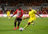 1st October 2020; Brentford Community Stadium, London, England; English Football League Cup, Carabao Cup Football, Brentford FC versus Fulham; Tariqe Fosu of Brentford covered by by Aleksandar Mitrovic of Fulham