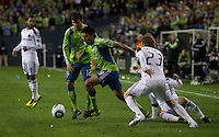 Leo Gonzales (19) of the Seattle Sounders drives upfield past teammate Nathan Sturgis (12)  against Los Angeles Galaxy defender David Beckham (23) in the first game of the 2010 MLS Playoffs at the XBox 360 Pitch at Quest Field in Seattle, WA on October 31, 2010. The Galaxy defeated the Sounders 1-0.