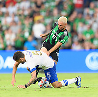 AUSTIN, TX - JUNE 19: Diego Fagundez #14 of Austin FC and Eric Remedi #5 of the SJ Earthquakes battle for control of a loose ball during a game between San Jose Earthquakes and Austin FC at Q2 Stadium on June 19, 2021 in Austin, Texas.