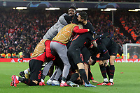 Atletico Madrid's Marcos Llorente is mobbed by team-mates as he celebrates scoring his side's first goal <br /> <br /> Photographer Rich Linley/CameraSport<br /> <br /> UEFA Champions League Round of 16 Second Leg - Liverpool v Atletico Madrid - Wednesday 11th March 2020 - Anfield - Liverpool<br />  <br /> World Copyright © 2020 CameraSport. All rights reserved. 43 Linden Ave. Countesthorpe. Leicester. England. LE8 5PG - Tel: +44 (0) 116 277 4147 - admin@camerasport.com - www.camerasport.com