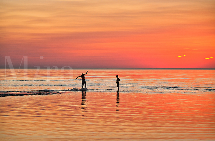 Boys boogie boarding in shallow water, Cape Cod, MA, Massachusetts, USA