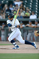 Right fielder Guillermo Granadillo (23) of the Columbia Fireflies bats in a game against the Rome Braves on Saturday, August 17, 2019, at Segra Park in Columbia, South Carolina. Rome won, 4-0. (Tom Priddy/Four Seam Images)