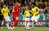 MOSCU - RUSIA, 03-07-2018: Juan CUADRADO (Der) jugador de Colombia disputa el balón con Jordan HENDERSON (Izq) jugador de Inglaterra durante partido de octavos de final por la Copa Mundial de la FIFA Rusia 2018 jugado en el estadio del Spartak en Moscú, Rusia. / Juan CUADRADO (R) player of Colombia fights the ball with Jordan HENDERSON (L) player of England during match of the round of 16 for the FIFA World Cup Russia 2018 played at Spartak stadium in Moscow, Russia. Photo: VizzorImage / Julian Medina / Cont