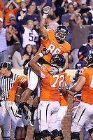 Oct 23, 2010; Charlottesville, VA, USA;  Virginia Cavaliers tight end Paul Freedman (88) celebrates his touchdown with teammate Virginia Cavaliers offensive linesman Oday Aboushi (72) during the 1st half of the game against the Eastern Michigan Eagles at Scott Stadium.  Mandatory Credit: Andrew Shurtleff