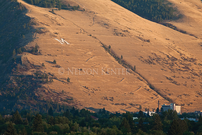 The trail to the M can be seen zig zagging up Mount Sentinel at sunset in Missoula, Montana