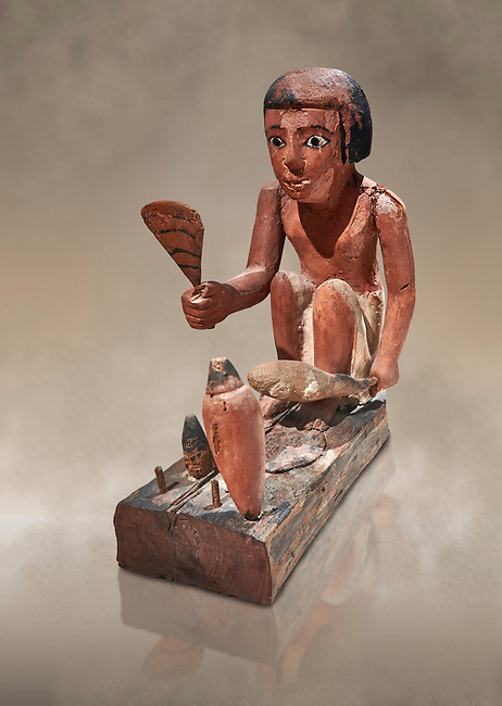 Ancient Egyptian wooden model of a man cooking a duck, New Kingdom, 11-13th Dynasty, (1980-1700 BC), Asyut. Egyptian Museum, Turin. Cat 8944. <br /> <br /> Wooden tomb models were an Egyptian funerary custom throughout the Middle Kingdom in which wooden figurines and sets were constructed to be placed in the tombs of Egyptian royalty. These wooden models represented the work of servants, farmers, other skilled craftsman, armies, and religious rituals