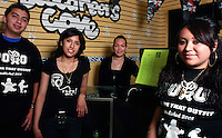 Mission Bay High School Students, (from L) Alan Ventura, Vanessa Zacarias, Pamela Villavicencio and Beatrice Cortez stand in the student-run store on Frday, April 25 2008.  The students and the rest of their Business 100 class formed a tee-shirt company called Put On That Outfit (POTO) as part of their studies.  They have sold roughly 48 of the t-shirts worn by Ventura, Vacarias and  Cortez in this image.