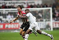 Pictured: Febian Brandy of Swansea (R) goes for the ball while being closely marlked by Jack Cork of Southampton (L). <br />