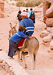 A bedouin child waits for his brother to mount their donkey, in the Wadi ad-Deir at the back of Petra, Jordan.  © Rick Collier