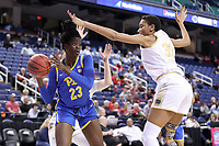 GREENSBORO, NC - MARCH 04: Rita Igbokwe #23 of the University of Pittsburgh is defended by Mikayla Vaughn #30 of Notre Dame University during a game between Pitt and Notre Dame at Greensboro Coliseum on March 04, 2020 in Greensboro, North Carolina.