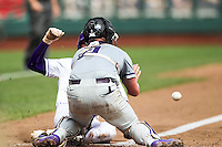 TCU Horned Frogs catcher Evan Skoug (9) blocks the plate against the LSU Tigers in the NCAA College World Series on June 14, 2015 at TD Ameritrade Park in Omaha, Nebraska. TCU defeated LSU 10-3. (Andrew Woolley/Four Seam Images)