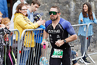 Pictured: Former Wales international Shane Williams runs on the South Parade, Tenby. Sunday 15 September 2019<br /> Re: Ironman triathlon event in Tenby, Wales, UK.