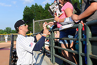 Right fielder Tyler Greene (9) of the Charlotte Knights signs autographs before a game against the Columbus Clippers on Saturday, June 15, 2013, at Knights Stadium in Fort Mill, South Carolina. Columbus won, 4-2. (Tom Priddy/Four Seam Images)