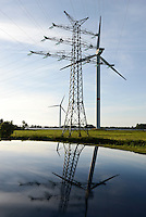 GERMANY Brunsbuettel, Repower 5 MW wind turbine and grid steel tower / DEUTSCHLAND, Windkraftanlage Repower 5M mit 5 MW Leistung vor Hochspannungsgittermast