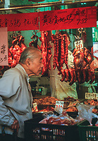San Francisco, California, Chinatown. Customer Examining Offerings at a Meat and Poultry Store.