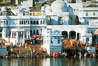 Ornate building from whose steps people bathe in the lake. Sacred site. Religions. Hinduism, customs, architecture. Pushkar India Asia.