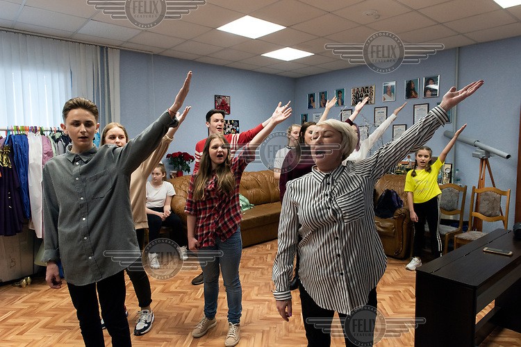 A music and dance group from the 'Prometheus Club' rehearse a routine dedicated to the 'Day of the Oil and Gas Industry workers'.The club teaches 370 children and has 24 vocal and dance groups.The club is financed by Gazprom Nadym Dobycha.