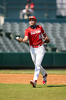 Third baseman Wes Kath (10) flips the ball to the pitcher during the Baseball Factory All-Star Classic at Dr. Pepper Ballpark on October 4, 2020 in Frisco, Texas.  Wes Kath (10), a resident of Scottsdale, Arizona, attends Desert Mountain High School.  (Ken Murphy/Four Seam Images)