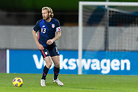 WIENER NEUSTADT, AUSTRIA - : Tim Ream #13 of the United States moves with the ball during a game between  at Stadion Wiener Neustadt on ,  in Wiener Neustadt, Austria.