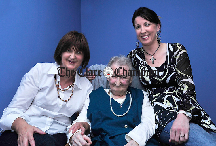 Susan Mc Inerney from Doora celebrating her 100th birthday with daughter Carmel and grandaughter Fiona. Photograph by Declan Monaghan