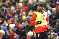 Daniel Sturridge warms up as a substitute during the Barclays Premier League Match between Liverpool and Swansea City played at Anfield, Liverpool on 29th November 2015