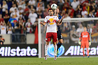 Fabian Espindola (9) of the New York Red Bulls goes up for a header with Jeff Parke (31) of the Philadelphia Union. The New York Red Bulls and the Philadelphia Union played to a 0-0 tie during a Major League Soccer (MLS) match at Red Bull Arena in Harrison, NJ, on August 17, 2013.