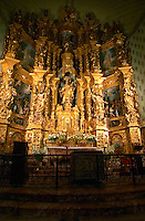 The church Eglise Notre Dame des Anges, our lady of the angels. The altar piece with intricately carved statues and a Madonna covered in opulent gold leaf gilt. Collioure. Roussillon. France. Europe.
