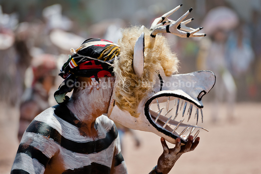 """A Cora Indian man, wearing a demon mask, takes a part in the religious ritual ceremony of Semana Santa (Holy Week) in Jesús María, Nayarit, Mexico, 21 April 2011. The annual week-long Easter festivity (called """"La Judea""""), performed in the rugged mountain country of Sierra del Nayar, merges indigenous tradition (agricultural cycle and the regeneration of life worshipping) and animistic beliefs with the Christian dogma. Each year in the spring, the Cora villages are taken over by hundreds of wildly running men. Painted all over their semi-naked bodies, fighting ritual battles with wooden swords and dancing crazily, they perform demons (the evil) that metaphorically chase Jesus Christ, kill him, but finally fail due to his resurrection. La Judea, the Holy Week sacred spectacle, represents the most truthful expression of the Coras' culture, religiosity and identity."""