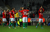 Saturday 17 November 2012<br /> Pictured L-R: Angel Rangel, Garry Monk, Kemy Agustien and Leon Britton of Swansea thank away supporters after the final whistle.<br /> Re: Barclay's Premier League, Newcastle United v Swansea City FC at St James' Park, Newcastle Upon Tyne, UK.