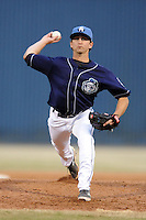 Asheville Tourists pitcher Logan Norris #8 delivers a pitch during a game against the Delmarva Shorebirds at McCormick Field on April 5, 2014 in Asheville, North Carolina. The Tourists defeated the Shorebirds 5-3. (Tony Farlow/Four Seam Images)