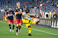 FOXBOROUGH, MA - MAY 16: Jonathan Mensah #4 Columbus SC kicks the ball back from the Columbus SC corner during a game between Columbus SC and New England Revolution at Gillette Stadium on May 16, 2021 in Foxborough, Massachusetts.
