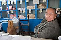 Cuba, Havana.  Store Clerk in a Small Shop, Old Havana.