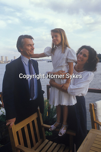 David Owen with daughter Lucy and wife Debbie. Politician 1980s England. In their Narrow Street Wapping east London apartment, views of the river Thames.