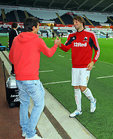 Pictured L-R: Federico Bessone and Michu of Swansea. Tuesday 28 August 2012<br /> Re: Capital One Cup game, Swansea City FC v Barnsley at the Liberty Stadium, south Wales.