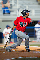 Amaurys Minier (39) of the Elizabethton Twins follows through on his swing against the Kingsport Mets at Hunter Wright Stadium on July 9, 2015 in Kingsport, Tennessee.  The Twins defeated the Mets 9-7 in 11 innings. (Brian Westerholt/Four Seam Images)