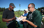 NFL Hall of Fame wide receiver Jerry Rice signs autographs during practice round in the American Century Celeb-Am Tournament at Edgewood Tahoe in Stateline, Nev., on Thursday, July 18, 2013.<br /> Photo by Cathleen Allison