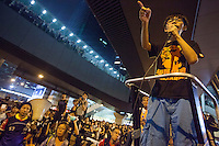 Student leader Joshua Wong addresses the pro-democracy crowds in front of the Hong Kong government offices on day three of the mass civil disobedience campaign Occupy Central, Hong Kong, China, 30 September 2014.
